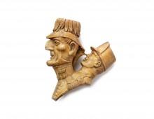 Clay pipehead mocking the Duke of Wellington. Copyright Apsley House / English Heritage.