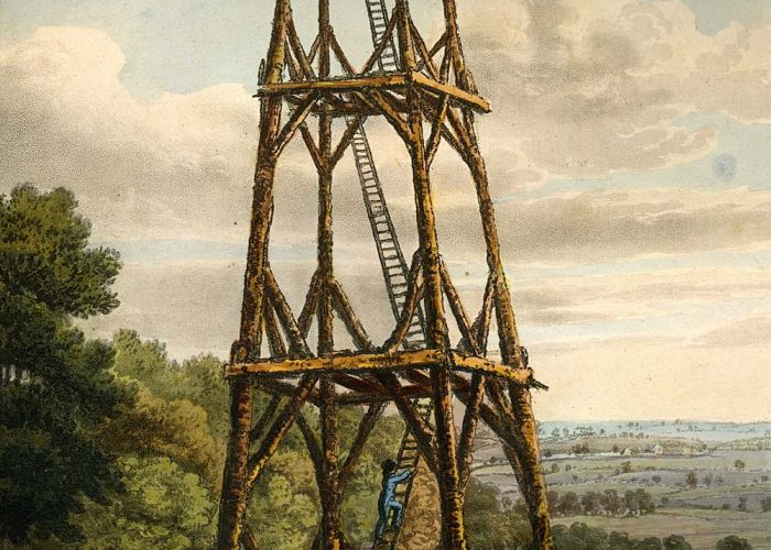 a print of a large wooden tower with ladders leading to an observation platform at the top
