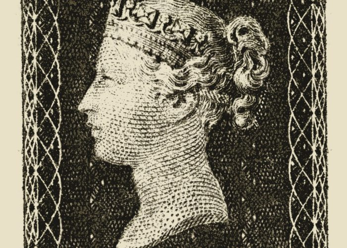 A scan of a black and white postage stamp showing Queen Victoria in the centre in profile.