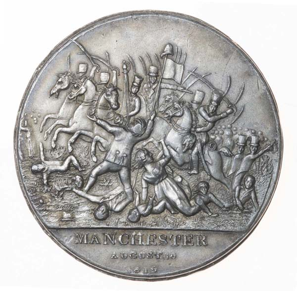 silver medal with engraving of soldiers on horeseback attacking a crowd