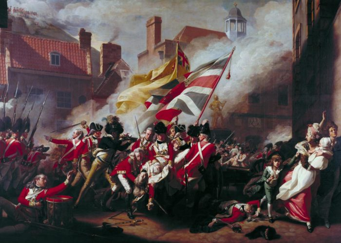 A painting of a battle scene within a town. Soldiers dressed in red military jackets can be seen fighting below two large union jack flags. In the centre of the frame a a man can be seen dying with other soldiers hodling him up. To the right of the frame civilians can be seen fleeing the scene.