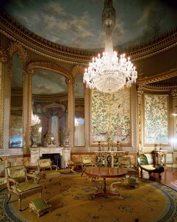 a photo of an ornate room with chandelier and gilded mirrors