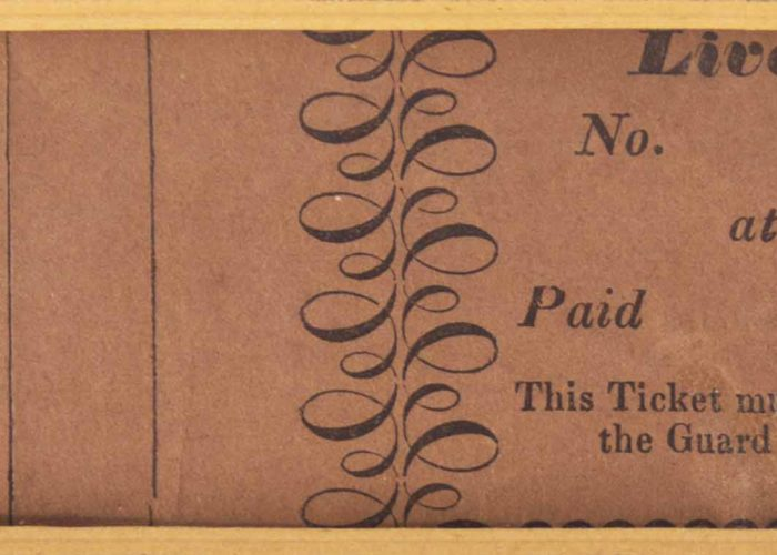A high resolution image of an old train ticket from Liverpool to Warrington. The ticket is a faded brown colour with black ink