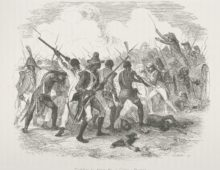 A black and white engraving showing a battle scene between Haitian and French armies. Many bayonets and swords can be seen and on the right hand side of the image a European soldier stands on a cannon wielding a sword.