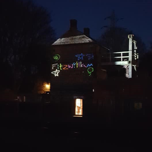 colourful projection onto side of building at night