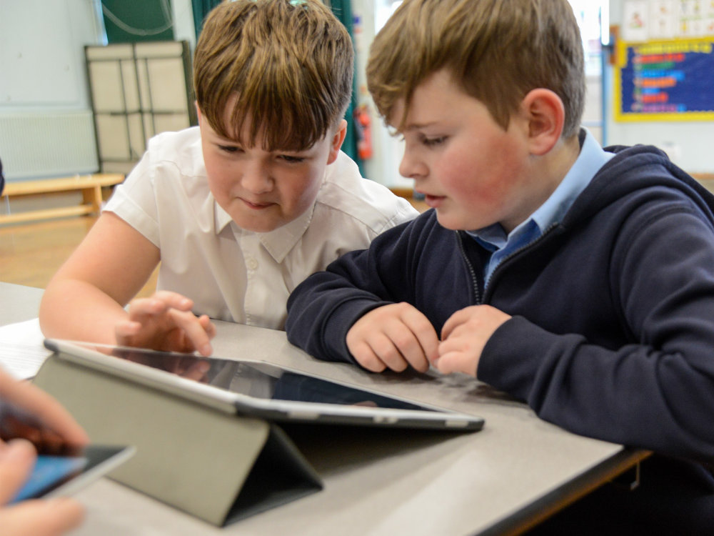 primary school students using tablet