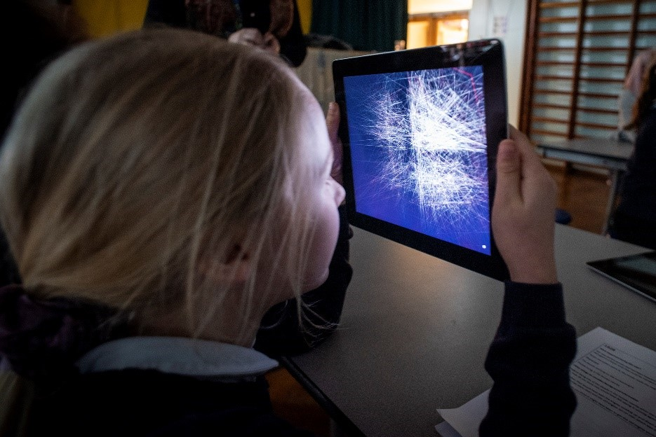student holding tablet